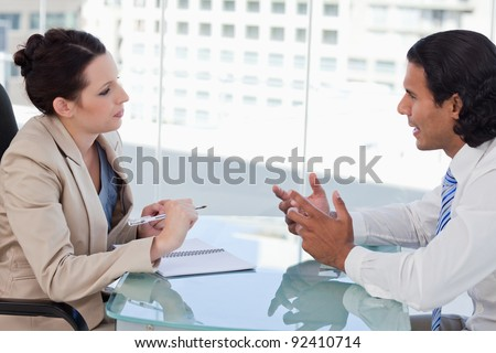 Young business people negotiating in a meeting room - stock photo