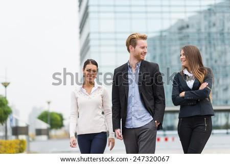 Young business people outdoors  - stock photo
