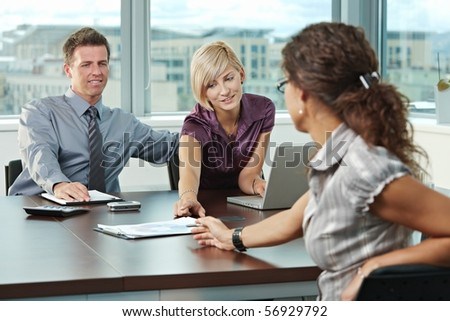 Young business people planning on table at office during business meeting. - stock photo