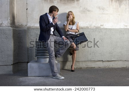 Young Business People Smoking Cigarettes - stock photo