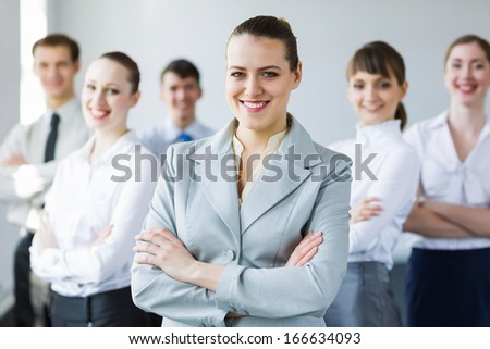 Young business people standing with arms crossed on chest - stock photo