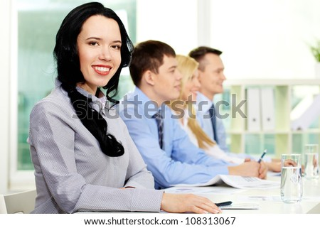 Young business people taking part in seminar, lovely girl being in the foreground - stock photo