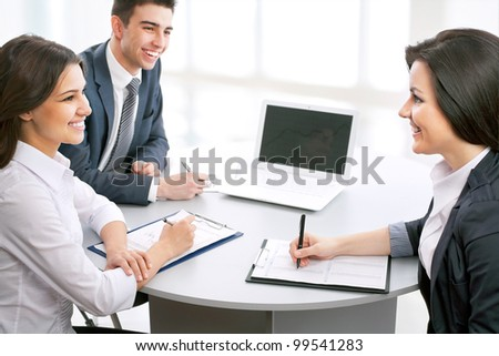 Young business people working in the office - stock photo