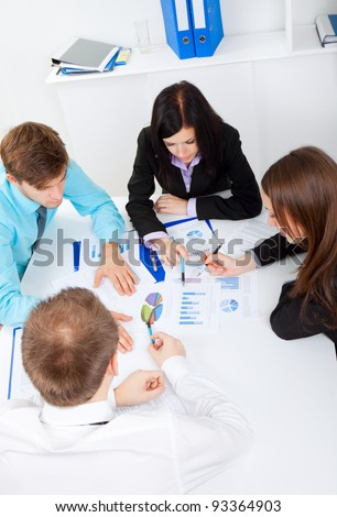 young business people working on project in team together, men and women discussing the problem, business plan, papers charts, document, businesspeople meeting sitting at desk office, above top view - stock photo
