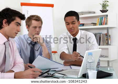 Young business professional discussing the results of a report - stock photo