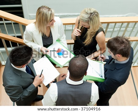 Young business team working on stairs - stock photo