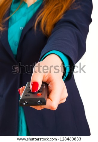 Young business woman and remote control panel TV - stock photo