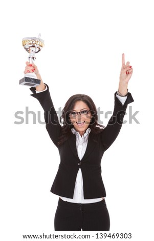 young business woman cheering with a trophy in her hand, happy to be number one . on white background - stock photo