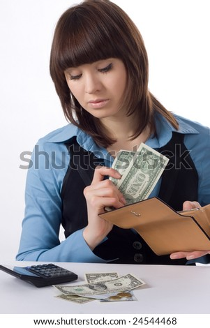 young business woman counts money isolated on white background - stock photo