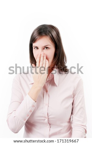 Young business woman covering with hand her mouth. - stock photo