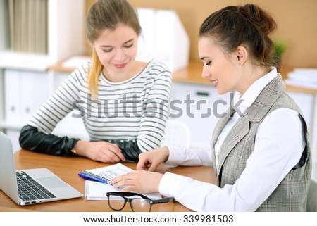 Young business woman designer discussing architecture project with client in office. Successful start up business concept.   - stock photo