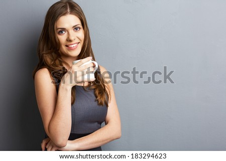 Young business woman drink coffee or tea. isolated gray. - stock photo