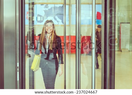 young business woman gets out the office. concept about business people and professions - stock photo