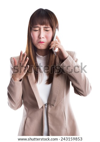 Young business woman got bad news on the phone, isolated on white background. - stock photo