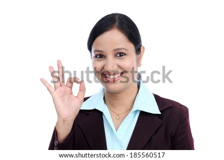 Young business woman hand gesture ok sign - stock photo