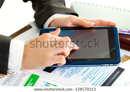 young business woman hands in office holding tablet pc - stock photo