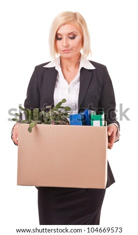 young business woman holding a box of belongings and documents - stock photo
