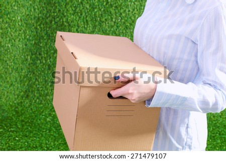 Young  business woman holding a  cardbox - stock photo