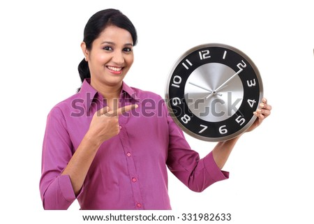 Young business woman holding clock in hands  - stock photo