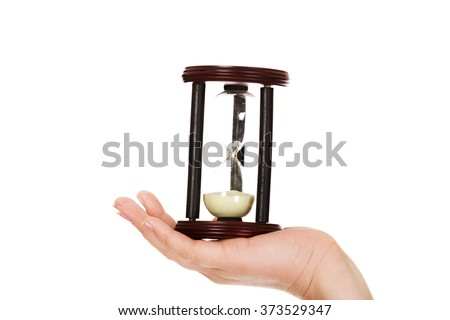 Young business woman holding hourglass-time concept - stock photo