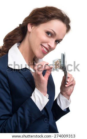 young business woman holding money. Isolated over white - stock photo
