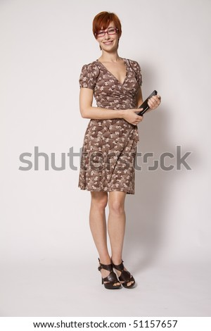 Young Business Woman Holding Notebook - stock photo