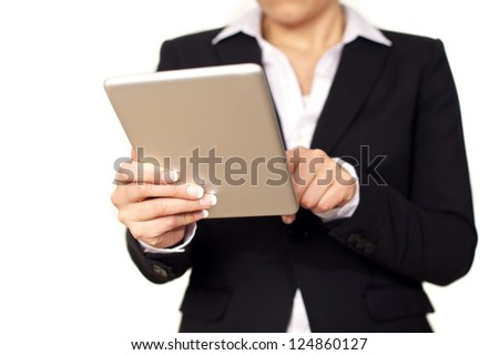 Young business woman in black suit using a digital tablet. Isolated on white background. - stock photo
