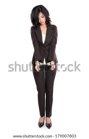 Young business woman in handcuffs isolated on white - stock photo