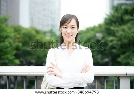 young business woman in the city - stock photo