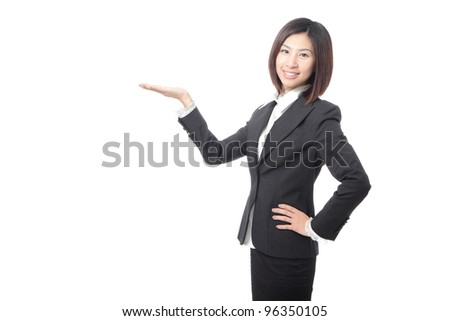 young business woman introducing something, isolated on white background, model is a asian beauty - stock photo