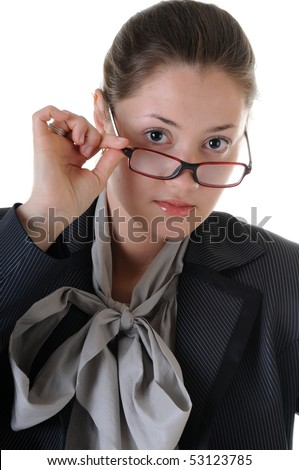 Young business woman is serious looking above glasses. Isolated on white background. - stock photo