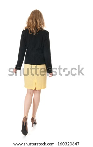 Young business woman is walking away - stock photo