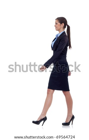 young business woman is walking. She is smiling and looking away from the camera isolated over white background - stock photo