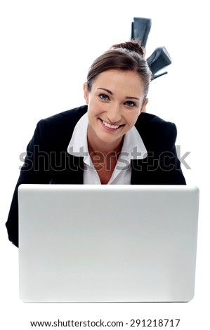 Young business woman laying and working in laptop - stock photo