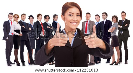 young business woman leader is very happy about the results , making the ok sign with her team behind, on white background - stock photo