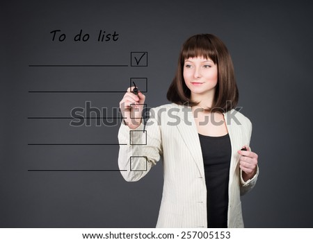 Young business woman listing to do list. Time management.  - stock photo