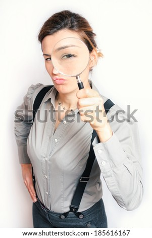 Young business woman magnifying - stock photo