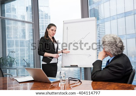 Young business woman making a presentation to the boss - stock photo