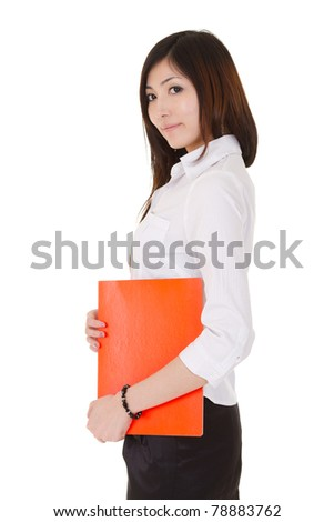 Young business woman of Asian holding a red document file, half length closeup portrait on white background. - stock photo