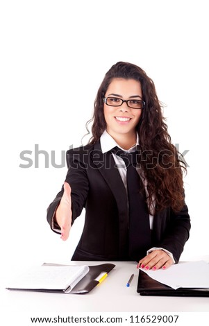 Young business woman offering handshake - stock photo