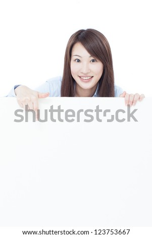 young business woman pointing blank billboard, isolated on white background - stock photo