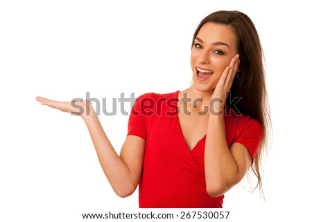 young business woman pointing to copy space, showing a product - stock photo