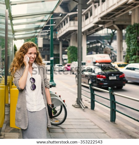Young business woman portrait talking in the street of Bangkok, Thailand.  - stock photo