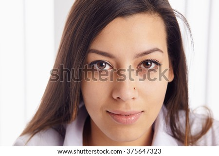 Young business woman posing over background. - stock photo