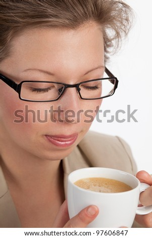 Young business woman relaxing at a coffee break - stock photo