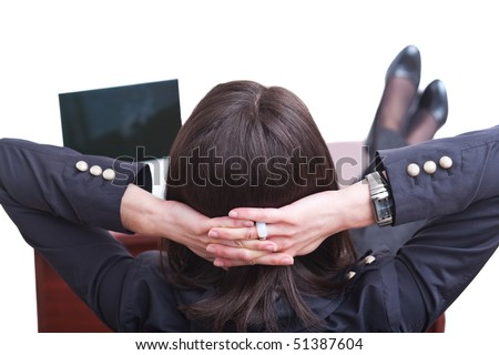 Young business woman relaxing seated with feet up on office desk. - stock photo