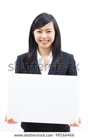 Young business woman showing billboard, isolated on white background - stock photo