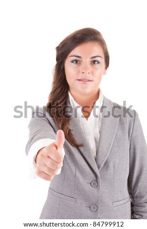 Young business woman showing thumbs up, isolated over white - stock photo