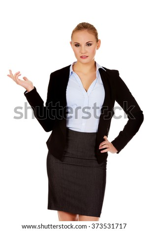 Young business woman shrugging with I dont know gesture - stock photo