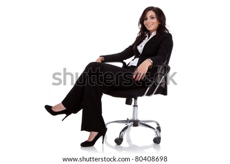 Young business woman sitting on a chair isolated on white - stock photo